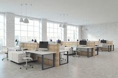 Modern coworking office. Modern white brick coworking office interior with furniture, equipment and city view with sunlight. 3D Rendering stock photography