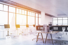 Modern coworking office toning. Modern coworking office interior with numerous workplaces, concrete floor, ceiling and panoramic windows with New York city view Royalty Free Stock Photography