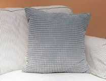 Gray Decorative Pillow on A Comfortable Sofa. Modern Cozy Sofa with Gray Decorative Square Pillow or Cushion, Close Up royalty free stock photography