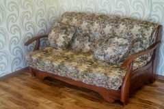 Modern cozy sofa in room. Close up sofa with cushions in room part of interior Royalty Free Stock Image