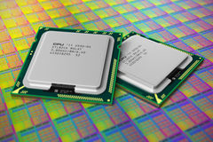 Modern CPUs on silicon wafer with processor cores. Macro view of modern CPUs on silicon wafer with processor cores. Shallow DOF effect Stock Photos