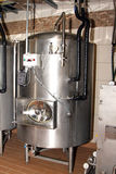 Modern craft beer stainless steel conditioning tanks. Royalty Free Stock Photos