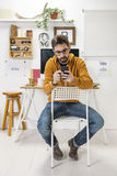 Modern creative man with smartphone on workspace. royalty free stock photo