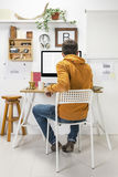 Modern creative man working on workspace. Stock Photos