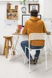 Modern creative man working on workspace. stock photo