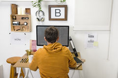 Modern creative man working on workspace. Stock Photo