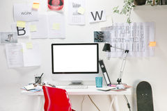 Modern creative workspace with computer and red chair. Stock Photo