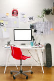 Modern creative workspace with computer and red chair. Royalty Free Stock Photography