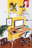 Modern creative workspace on yellow wall. Stock Photography