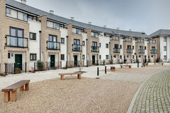 Modern crescent of townhouses and apartments. Modern crescent of townhouse and apartments typical of those currently under construction within many towns and Stock Photo