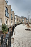 Modern crescent of townhouses and apartments. Modern crescent of townhouse and apartments typical of those currently under construction within many towns and Stock Images