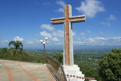 Modern cross overlooking the valley of Cibao in Santo Cerro, Dominican Republic. Stock Photos