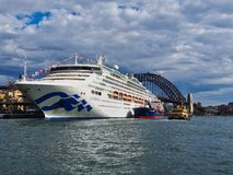 Modern Cruise Ship Docked in Circular Quay, Sydney, Australia. A large white modern cruise ship docked at the International Departures Terminal, Circular Quay royalty free stock images