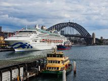 Modern Cruise Ship Docked in Circular Quay, Sydney, Australia. A large white modern cruise ship docked at the International Departures Terminal, Circular Quay royalty free stock photo