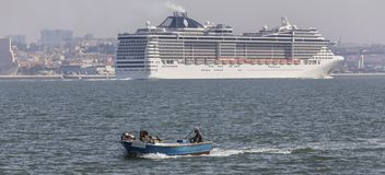 Modern cruise ship in front of lisbon portugal Stock Photo