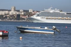Modern cruise ship in front of lisbon portugal Stock Images