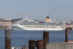 Modern cruise ship in front of lisbon portugal Stock Image