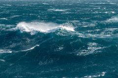 Modern cruise ship traveling through rough seas royalty free stock photos