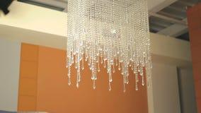 Modern crystal chandelier on fashion ceiling. 4K stock video