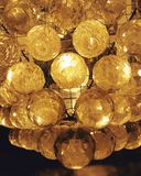 Modern crystal lamp, yellow light, abstract, shiny glossy royalty free stock photo