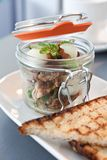 Modern cuisine breakfast served in a small preserving jar. With triangles of soudough toast Stock Image