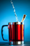 Modern cup with flowing water stock images