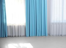 Modern curtains in room. Modern curtains in living room stock images
