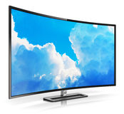 Modern curved 4K UltraHD TV Stock Photo