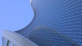 Modern curved skyscraper against blue sky. Modern skyscraper against sky. Twisted design stock photography