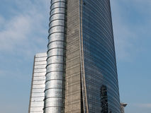 Modern Curved Skyscraper with Shiny Glass Facade Stock Images