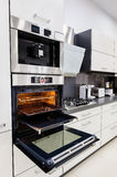 Modern custom hi-tek kitchen, oven with open door Royalty Free Stock Photos