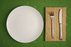 Modern Cutlery set on green fabric background Stock Image