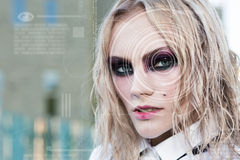 Modern cyber punk woman with digital eye Royalty Free Stock Images