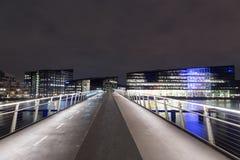 Modern cyclist and pedestrian bridge Bryggybroen in Copenhagen by night. Copenhagen, Denmark - March 22, 2016: Modern cyclist and pedestrian bridge Bryggybroen Stock Image