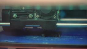Modern 3D printer applying ABS plastic on surface and printing figure stock video footage