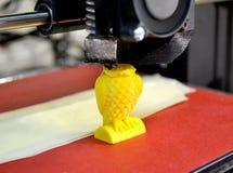 Modern 3D printer printing figure close-up. stock photos