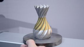 Modern 3D printer printing from metal powder. Object printed on metal 3d printer close-up. Object printed in laser sintering machine. Modern 3D printer printing stock footage