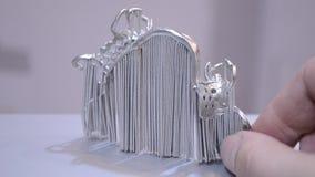 Modern 3D printer printing from metal powder. Object printed on metal 3d printer. Dental crowns printed in laser sintering machine. Modern 3D printer printing stock video