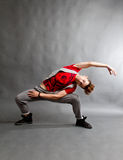 Modern dance. Performer in studio busting a move royalty free stock photo