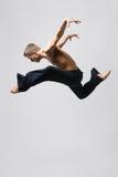 Modern dance. Young modern danecr posing over white background Stock Photo