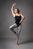 Modern dance. Young and beautiful modern style dance posing stock images