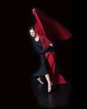 Modern dance. Ballerina in studio dancing modern dance with red stock images