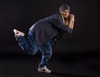 Modern dance. Hip-hop. Modern dance, hip hop girl dancer on a black background stock photography