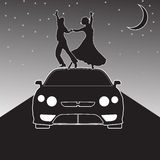 Modern dance. Man and woman dancing on a car roof Royalty Free Stock Photos