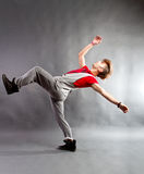 Modern dancer. Modern style dancer performing on studio background stock photo