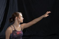 Modern Dancer close up. A close up view of a modern dancer reaching with left arm Stock Images