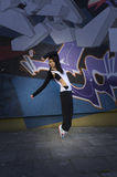 Modern dancer girl and graffiti Stock Photos