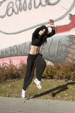 Modern dancer girl near graffiti Stock Images