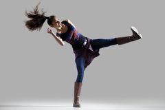 Modern dancer girl. Stylish dancing young woman portrait. Fit athletic girl wearing British flag tank top warming up, working out with her long ponytail flying royalty free stock photo
