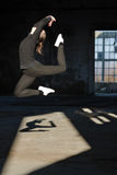 Modern dancer jumping high in abandoned building Stock Images